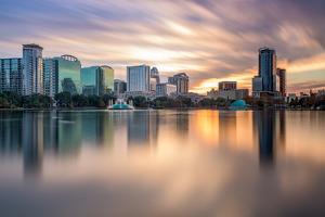 Orlando, Florida, USA Skyline at Eola Lake. by SeanPavonePhoto