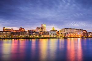 Savannah, Georgia, USA Downtown Skyline at the Riverfront at Dusk. by SeanPavonePhoto