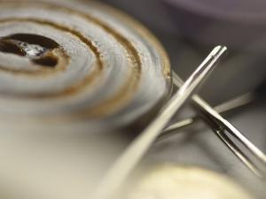 Selective Focus of Button with Sewing Needle and Thread