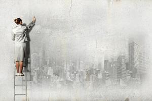 Businesswoman Standing on Ladder and Drawing Sketch on Wall by Sergey Nivens