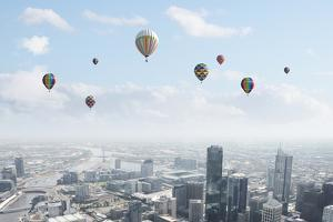 Conceptual Image with Colorful Balloons Flying High in Sky by Sergey Nivens