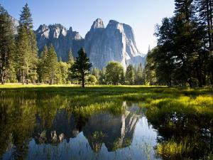 A Calm Reflection of the Cathedral Spires in Yosemite Valley in Yosemite, California by Sergio Ballivian