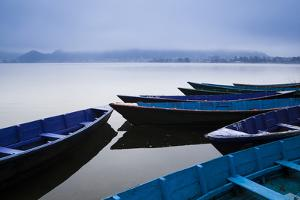 A Cold Front Brings a Low-Lying Fog Above Phewa Lake Next to Pokhara, Nepal by Sergio Ballivian