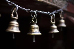 Brass Bells Hang at the Entryway to a Temple in Kathmandu, Nepal by Sergio Ballivian