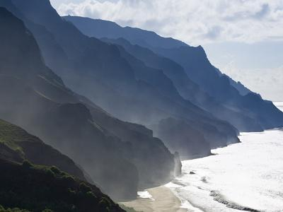 The Fluted Ridges of the Na Pali Coast Above the Crashing Surf on the North Shore of Kauai, Hawaii.