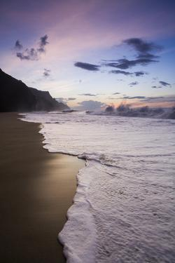 The Ridges of the Na Pali Coast Rise Above the Crashing Surf on the North Shore of Kauai, Hawaii by Sergio Ballivian