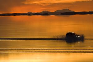 The Salar De Uyuni, a Flooded Salt Flat, in Bolivia by Sergio Ballivian