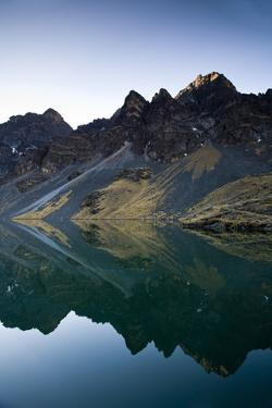 The Waters of Laguna Llivinosa Reflect the Rugged Peaks of Bolivia's Cordillera Real of the Andes by Sergio Ballivian
