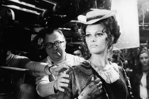 Sergio Leone (1929 - 1989) and Claudia Cardinale during the shooting of Once Upon a Time in the Wes