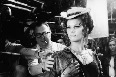 https://imgc.allpostersimages.com/img/posters/sergio-leone-1929-1989-and-claudia-cardinale-during-the-shooting-of-once-upon-a-time-in-the-wes_u-L-Q1C28A80.jpg?artPerspective=n