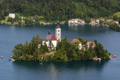 A view from above of Lake Bled and the Assumption of Mary Pilgrimage Church, Slovenia, Europe by Sergio Pitamitz
