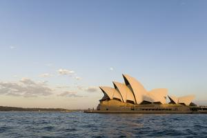 A View of the Sydney Opera House from across the Harbor at Sunset by Sergio Pitamitz