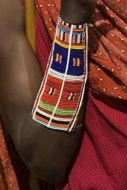 Africa, Kenya, Amboseli National Bark, beaded Masai arm and wrist by Sergio Pitamitz