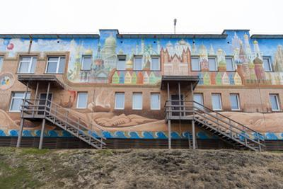An Apartment Building Adorned with Colorful Murals by Sergio Pitamitz