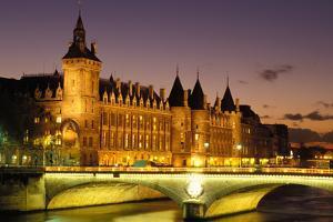 France, Paris, Conciergerie and river Seine at dusk. by Sergio Pitamitz