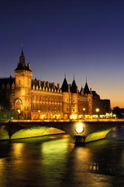 France, Paris, River Seine and Conciergerie at dusk. by Sergio Pitamitz