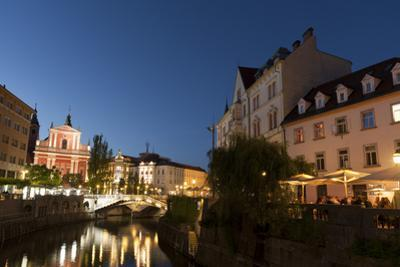Franciscan Church of the Annunciation and Triple Bridge over the Ljubljanica River at dusk, Ljublja by Sergio Pitamitz