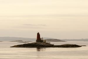 Gjaeslinga Lighthouse Set on a Small Rock Island Among Islands in the Norwegian Sea by Sergio Pitamitz