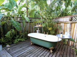 Open Air Bath at Luxury Hotel, Formerly Ian Fleming's House, Goldeneye, St. Mary by Sergio Pitamitz