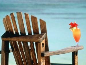 Seychelles, Denis Island, beach chair and fruit cocktail by Sergio Pitamitz