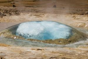 Strokkur Geyser Starting to Erupt by Sergio Pitamitz