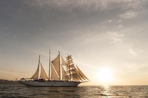 The Star Flyer Sailing Cruise Ship Underway at Sunset by Sergio Pitamitz