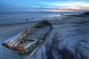 Old Abandoned Broken Boat at Sea against Sea Landscape. by sergoua