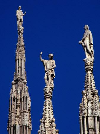Stone Statues Stand Atop the Spires of the Duomo, Milan, Lombardy, Italy