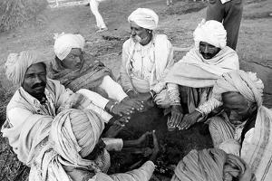 Seven Men Warming Hands in Winter Cold, Vautha Fair, Gujarat, India, 1983