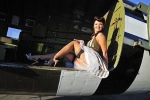 Sexy 1940's Style Pin-Up Girl Sitting Inside of a C-47 Skytrain Aircraft