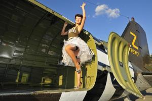 Sexy 1940's Style Pin-Up Girl Standing Inside of a C-47 Skytrain Aircraft