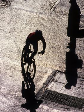 Shadow and Silhouette of Cyclistist and Pedestrian, New York, New York, USA