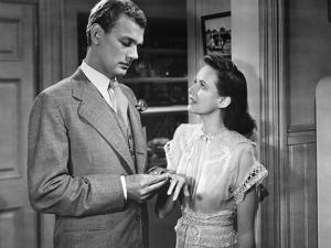 SHADOW OF A DOUBT, 1943 directed by ALFRED HITCHCOCK Joseph Cotten / Teresa Wright (b/w photo)