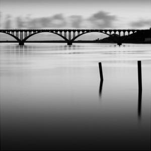 Bridge and Poles in Black and White by Shane Settle