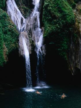 Swimmers at Salto Del Caburni Waterfall, Sierra Del Escambray, Topes De Collantes, Cuba by Shannon Nace