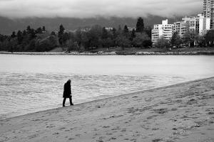 Figure Walking Alone Along Beach in Winter by Sharon Wish