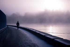 Winter Scene Male Figure Walking Along Pathway Beside Lake by Sharon Wish