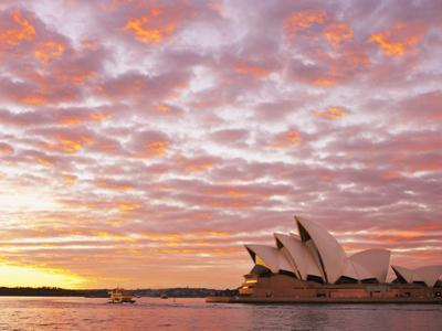 Australia, New South Wales, Sydney, Sydney Opera House, Boat in Harbour at Sunrise by Shaun Egan