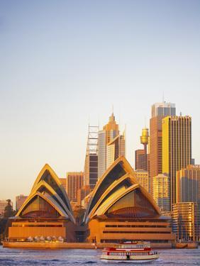 Australia, New South Wales, Sydney, Sydney Opera House, Passenger Ferry Passing Opera House by Shaun Egan