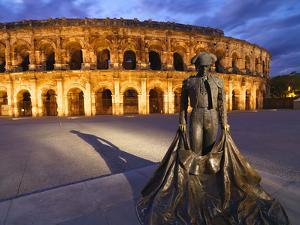 France, Provence, Nimes, Roman Ampitheatre, Toreador Statue at Dusk by Shaun Egan