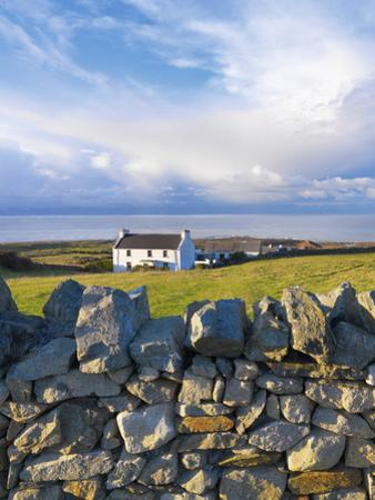 Ireland, Co.Donegal, Fanad, House and stone wall by Shaun Egan