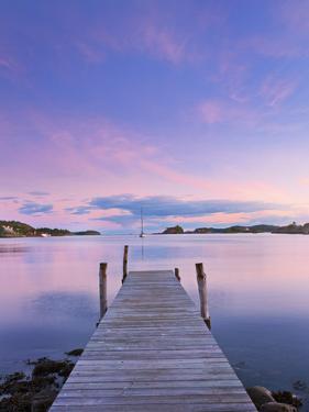 Norway, Oslo, Oslo Fjord, Jetty over Lake at Dusk by Shaun Egan