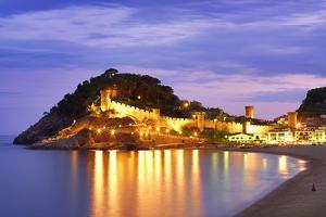 Spain, Catalonia, Costa Brava, Tossa De Mar, Overview of Bay and Castle at Dusk (Mr) by Shaun Egan