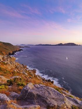 Spain, Galicia, Cangas, Yacht Sailing in Sea at Dusk by Shaun Egan