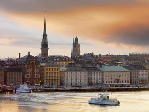 Sweden, Stockholm, Riddarfjarden, Gamla Stan, Passenger Ferries in Bay at Dusk by Shaun Egan