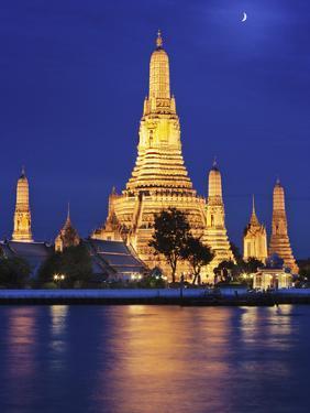 Thailand, Bangkok, Wat Arun Temple at Night by Shaun Egan