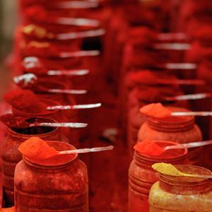 Red Tikka (Or Kumkuma) Powder at Kalighat in Calcutta (Kolkata) in West Bengal in India by Shaun Higson India-Kolkata