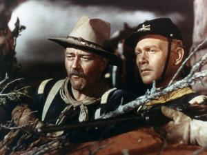 SHE WORE A YELLOW RIBBON, 1949 directed by JOHN FORD John Wayne and Harry Carey Jr (photo)