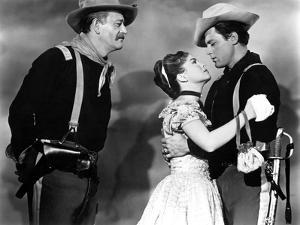 SHE WORE A YELLOW RIBBON, 1949 directed by JOHN FORD John Wayne, Joanne Dru and John Agar (b/w phot