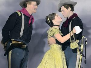SHE WORE A YELLOW RIBBON, 1949 directed by JOHN FORD John Wayne, Joanne Dru and John Agar (photo)
